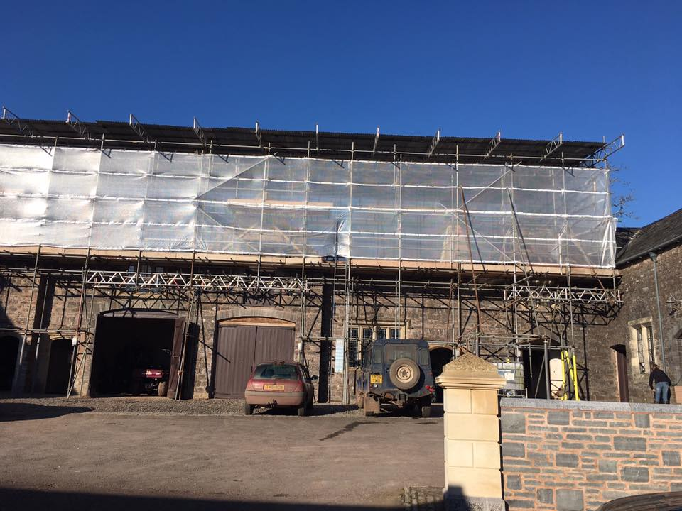 scaffolding and sheeting around large domestic property