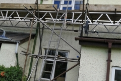 domestic property with scaffolding access to the roof