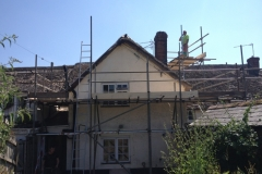 commercial property with scaffolding and dust nets around it