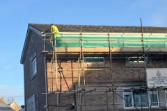 scaffolder up on the scaffolding around property