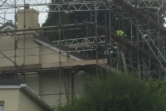 internals of property with scaffolding being erected around it