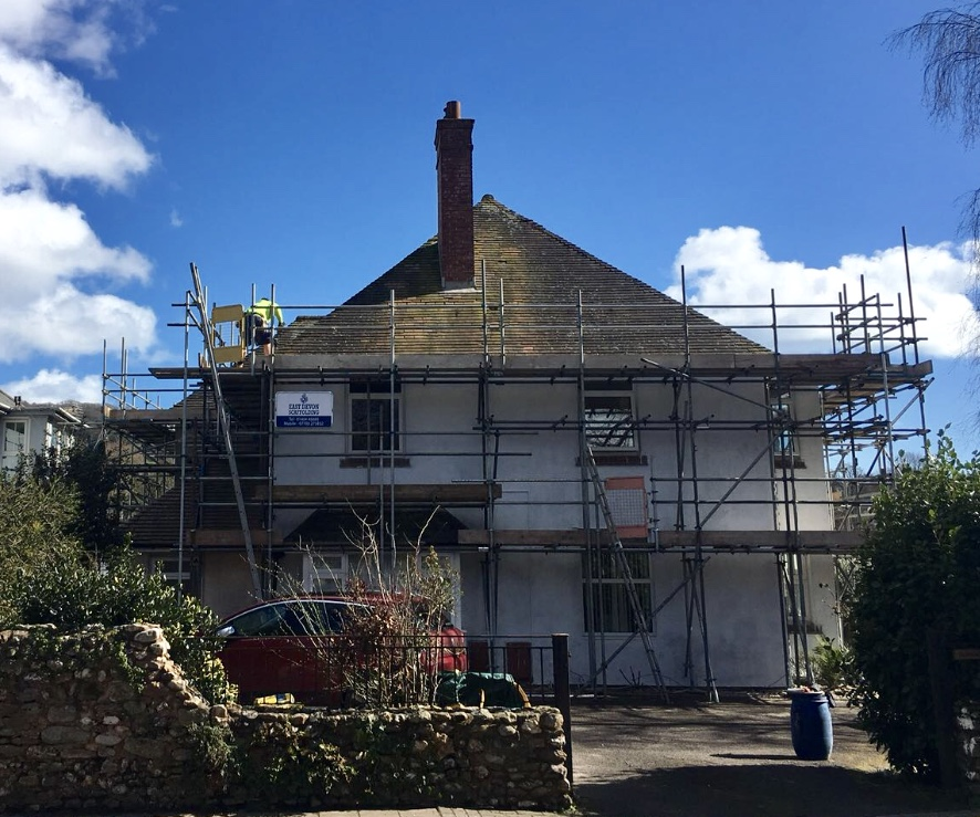 scaffolding on old white cottage